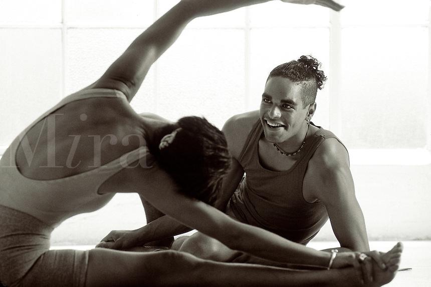 Couple doing yoga together.