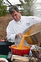 Royal York Hotel's Executive Chef David Garcelon pours alarge quantitiy of  rich golden sauce at Slow Food's Picnic at the Brick Works in Toronto, 2010.