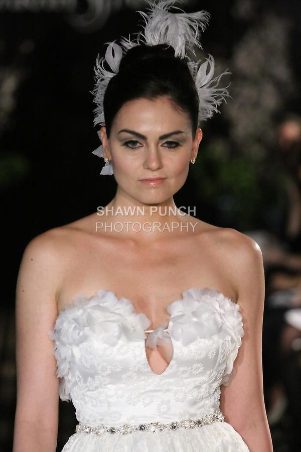 Model walks runway in an Enchanted wedding dress by Sarah Jassir, for the Sarah Jassir Fall 2011 - Desire bridal collection.