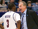 HARTFORD, CT. 03 February 2007-020307SV10--UConn Coach Jim Calhoun has a few words with #3 Doug Wiggins about a play against Rutgers during basketball action at the Hartford Civic Center in Hartford Saturday.<br /> Steven Valenti Republican-American