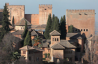 Towers of the Alhambra Palace seen from the Generalife, Granada, Andalusia, Southern Spain. The Alhambra was begun in the 11th century as a castle, and in the 13th and 14th centuries served as the royal palace of the Nasrid sultans. The huge complex contains the Alcazaba, Nasrid palaces, gardens and Generalife. Granada was listed as a UNESCO World Heritage Site in 1984. Picture by Manuel Cohen