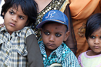 Indian children in back of truck at Mehrauli, New Delhi, India