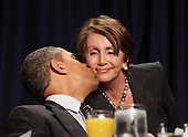 United States House Minority Leader Nancy Pelosi (Democrat of California) receives a kiss from U.S. President Barack Obama after speaking to the National Prayer Breakfast in Washington, DC, February 2, 2012. .Credit: Chris Kleponis / Pool via CNP