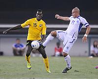 El Salvador midfielder Dennis Alas (14) goes against Jamaica midfielder Je-vaughn Watson (15)  Jamaica defeated El Salvador 2-0 in a international friendly match at RFK Stadium, Wednesday August 15, 2012.