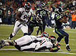 Seattle Seahawks running back Thomas Rawls runs though the tackle of Denver Broncos safety Josh Furman (41) and during the fourth quarter at CenturyLink Field on August 14, 2015 in Seattle Washington.  Rawls run for a touchdown on a 19-yard pass from quarterback A.J. Archer. The Broncos beat the Seahawks 22-20.  © 2015. Jim Bryant Photo. All Rights Reserved.