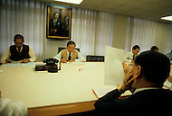 Hong Kong, China - September 25, 1981. Picture of Y.K. Pao and associates at the conference table in Hong Kong. Y.K. Pao (November 10, 1918 - September 23, 1991) was founder of the World-Wide Shipping Group that by the mid 1970's had become the largest shipping company in the world.