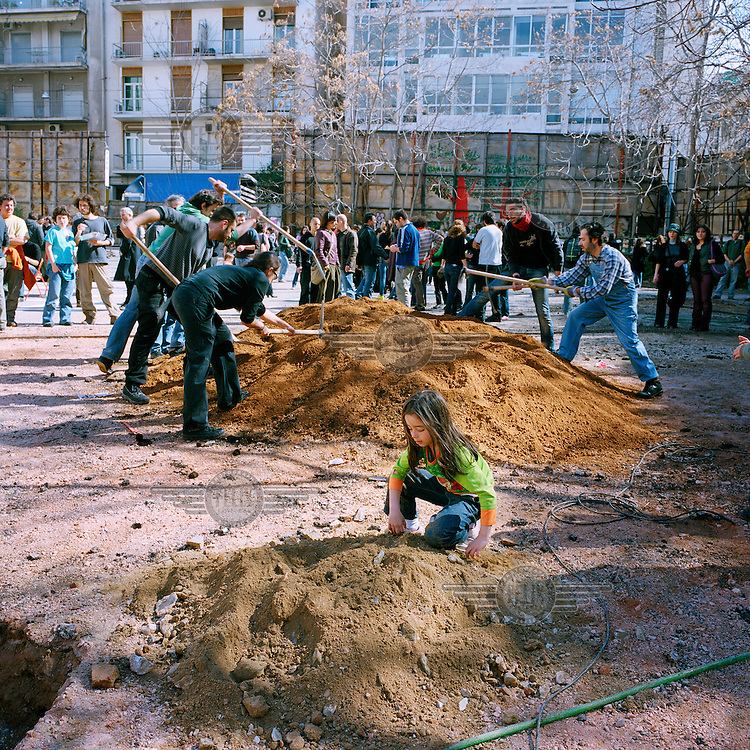 People work transforming a parking lot into a park (without the council's permission) in the Exarchia neighbourhood of central Athens. Exarchia has a rich history of radicalism. Ever since the foundation of the National Technical University in 1836, the area has been home to anarchists, free thinkers, artists, intellectuals and students..