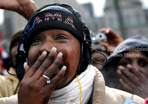 Baltimore, MD - January 17, 2009 -- Laterra Hopkins listens as United States President-elect Barack Obama delivers remarks during a rally at War Memorial Plaza, during a stop on their Whistle Stop Train Tour, in Baltimore, Maryland on Saturday, January 17, 2009. The ceremonial trip will carry President-elect Obama, Vice President-elect Biden and their families to Washington for their inaugurations with additional events in Philadelphia, Wilmington and Baltimore. Obama will be sworn in as the 44th President of the United States on January 20, 2009.   .Credit: Kevin Dietsch - Pool via CNP