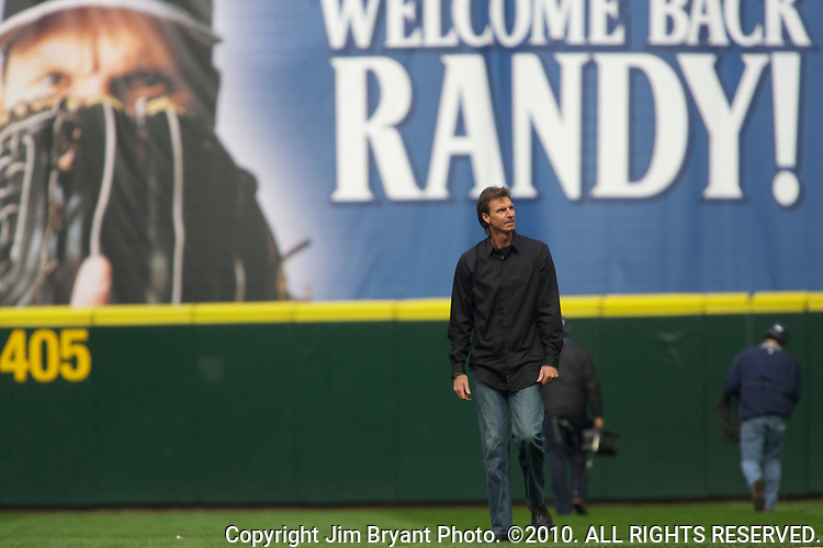 Former Seattle Mariners pitcher Randy Johnson walks onto the field to toss out the Ceremonial first pitch in the Seattle Mariners opening home game of the season against the Oakland Athletics at SAFECO Field in Seattle April 12, 2010. Johnson, who retired from Major league baseball after pitching 22 seasons, compiled a 103-74 (.637) record with a 3.42 ERA in his 10 seasons with the Mariners.  The Athletics beat the Mariners 4-0.      Jim Bryant Photo. ©2010. ALL RIGHTS RESERVED.