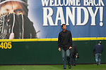 Former Seattle Mariners pitcher Randy Johnson walks onto the field to toss out the Ceremonial first pitch in the Seattle Mariners opening home game of the season against the Oakland Athletics at SAFECO Field in Seattle April 12, 2010. Johnson, who retired from Major league baseball after pitching 22 seasons, compiled a 103-74 (.637) record with a 3.42 ERA in his 10 seasons with the Mariners.  The Athletics beat the Mariners 4-0.      Jim Bryant Photo. &copy;2010. ALL RIGHTS RESERVED.