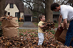 Sam helps Ted bag leaves in our front yard. Sam is three and a half years old.