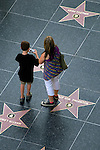 Tourists vsiting the Hollywood Blvd. Walk of Fame