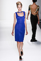Model walks runway a SAPPHIRE HANDLOOMED RAYON KNIT SLEEVELESS COCKTAIL DRESS W/.SAPPHIRE CRYSTAL DRAPED-BACK NECKLACE W/IMPERIAL STAR by Zang Toi, for the Zang Toi Spring 2012 My Dream Of North Africa Collection, during Mercedes-Benz Fashion Week Spring 2012.