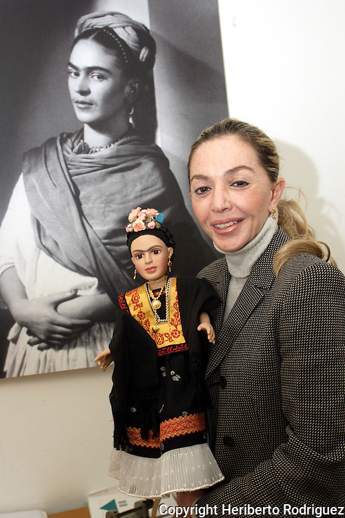 Cristina Dorsett cradles a Frida Khalo collection doll as is annouced to be launched in Mexico City on December 14. The 20-inch Frida Khalo doll is clad in a traditional Mexican dress. Miss Dorsett is the owner of the doll factory where they were made. Frida Khalo Corporation, leaded by Frida's niece Isolda Khalo, has marketed Frida Kahlo jewellery and clothing after winning the rights to register the name as a brand. Photo by Heriberto Rodriguez