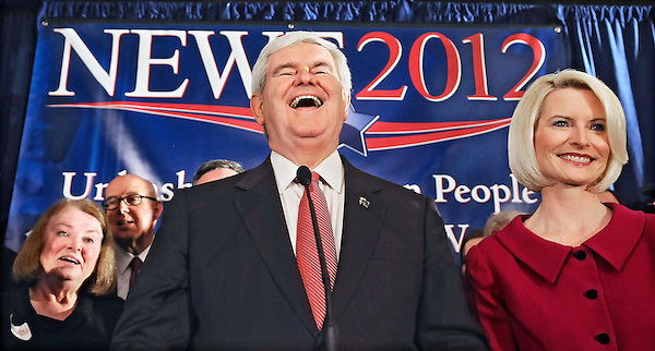 Columbia, South Carolina: January 21, 2012<br /> <br /> A smile creases the face of presidential candidate Newt Gingrich as he celebrates his victory in the South Carolina presidential primary election. His wife Callista Gingrich stands beside him. This election night party  happened at the Hilton Hotel. &copy;Chris Fitzgerald / CandidatePhotos