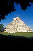 El Castillo or Pyramid of Kukulcan framed by trees, Chichen Itza, Yucatan, Mexico