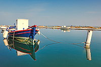 A fishing boat tied up in shallow waters in the city of Lefkada, Greece