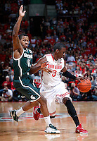 Ohio State Buckeyes guard Shannon Scott (3) tries to drive past Michigan State Spartans guard Keith Appling (11) in the second half of the NCAA men's basketball game between the Ohio State Buckeyes and the Michigan State Spartans at Value City Arena in Columbus, Ohio, Sunday afternoon, March 9, 2014. The Ohio State Buckeyes defeated the Michigan State Spartans 69 - 67. (The Columbus Dispatch / Eamon Queeney)