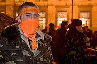 Kiev, Ukraine, 28/12/2004..The third and final round of Ukraine's disputed Presidential election. Supporters of candidate Viktor Yushchenko camped out in the city centre streets: masked guards at the barricades.