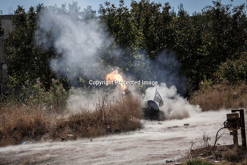 In this Monday, Oct. 07, 2013 photo, shows a piece of heavy artillery being shell during an attack by opposition fighters (not pictured) over Wadi Al-Deef military post at the frontline in Maraat Anouman in the Idlib province countryside of Syria. (AP/Photo)