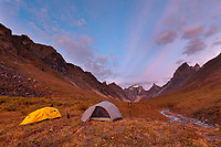 Campsite on a mountain ridge, morning light on Xanadu, Arial and Caliban peaks, Arrigetch creek, Gates of the Arctic National Park, Alaska.