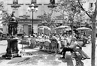 Place St.Andre Des Arts. Paris, August 1977. August in Paris is a noveable feast. While millions of residents are leaving for their favourite resorts, thousands of foreign tourists are flocking to the French Capital. Nevertheless, genuine Parisians, old and young alike, stay in Paris and mantain the tradition charm.