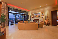 Modern design family room with fireplace captured at dusk
