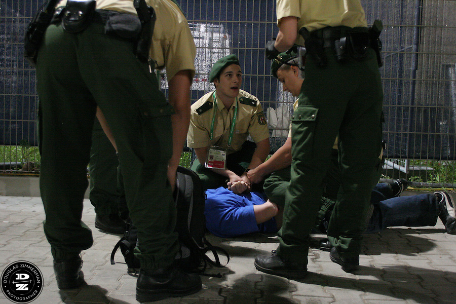 German police officers arrest an unidentified fan outside the Kaiserslautern stadium after the FIFA World Cup First round match against Italy on Saturday June 17th, 2006 in Kaiserslautern, Germany.  The USA and Italy tied 1-1.