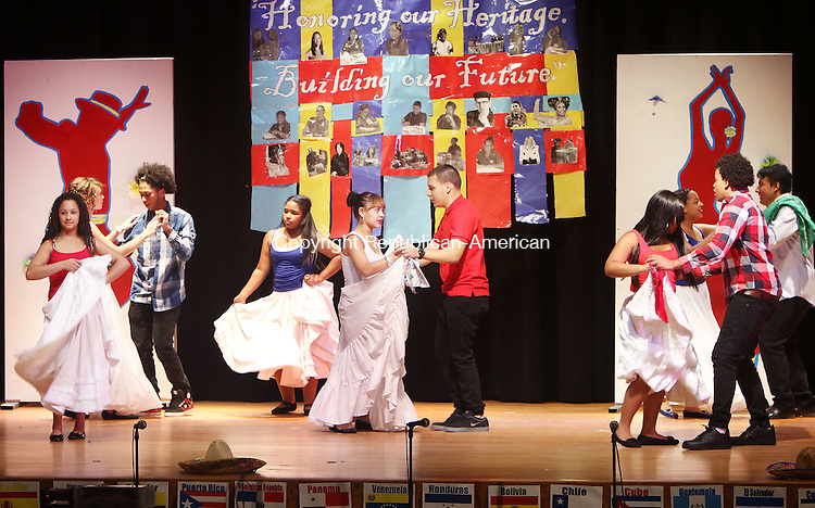 WATERBURY CT. 26 October 2015-102715SV06-Wilby High Students perform a dance called, &ldquo;Bomba Perico Ripiao&rdquo;, during the annual Hispanic Heritage Month celebration at Crosby High in Waterbury Tuesday. Students from around the district gathered at Crosby High School to watch performances of Hispanic culture by students of all ages.  <br /> Steven Valenti Republican-American