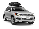 Silver 2011 Volkswagen Touareg mid-size crossover SUV with a roof box. Isolated car on white background with clipping path.