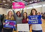 """Westbury, New York, USA. January 15, 2017.  L-R, SUE MOLLER of Merrick, AMY BUDD of Bellmore, STEFANA MULLER of Babylon, and BETH MCMANUS of Seaford, the Administrators of Together We Will Long Island, TWWLI, are holding protest signs at the """"Our First Stand"""" Rally against Republicans repealing the Affordable Care Act, ACA, taking millions of people off health insurance, making massive cuts to Medicaid, and defunding Planned Parenthood.  It was one of dozens of nationwide Bernie Sanders' rallies for health care that Sunday."""