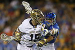 29 April 2016: Notre Dame's Cole Riccardi (15) and Duke's John Prendergast (6). The University of Notre Dame Fighting Irish played the Duke University Blue Devils at Fifth Third Bank Stadium in Kennesaw, Georgia in a 2016 Atlantic Coast Conference Men's Lacrosse Tournament semifinal match. Duke won the game 10-9 in overtime.