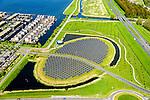 Nederland, Flevoland, Gemeente Almere, 07-05-2015; nieuwbouwwijk Noorderplassen-West met Zoneiland Almere. De zonnecollectoren op het eiland verwarmen water wat aan het stadswarmtenet wordt toegevoegd.<br /> Solar panels on Sun island in the new constructed residential district in Almere providing city heating<br /> luchtfoto (toeslag);<br /> aerial photo (additional fee required); <br /> copyright foto/photo Siebe Swart.