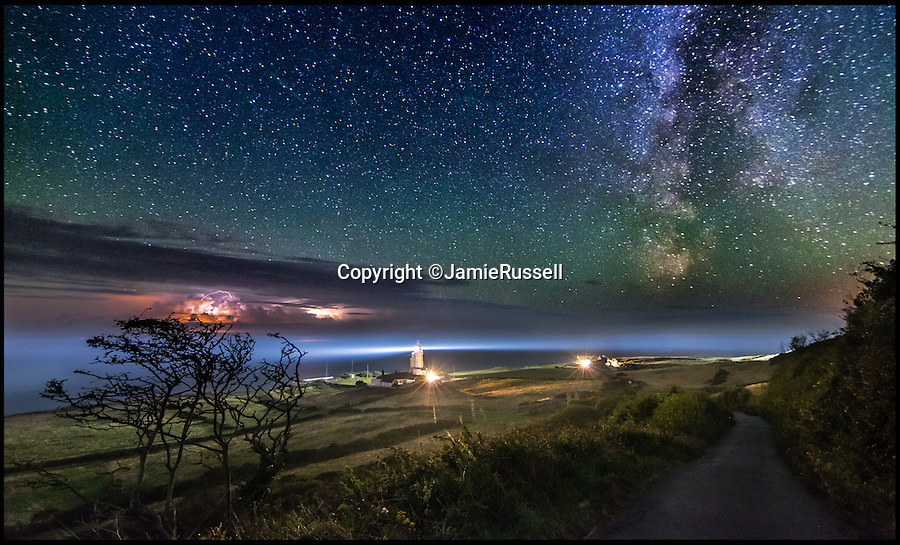 BNPS.co.uk (01202 558833)<br /> Pic: JamieRussell/BNPS<br /> <br /> ***Please Use Full Byline***<br /> <br /> A distant storm and the Milky Way over St Catherine's Lighthouse, Isle of Wight.<br /> <br /> Stunning photographs have revealed a turbulent side to the normally genteel Isle of Wight.<br /> <br /> The seemingly benign south coast holiday destination has been catalogued over a stormy year by local photographer Jamie Russell, and his astonishing pictures reveal the dramatic changes in weather that roll across the UK in just 12 months.<br /> <br /> Lightning storms, ice, floods, gales and blizzards have all been captured by the intrepid photographer who frequently got up in the middle of the night to capture the climatic chaos.<br /> <br /> Looking at these pictures prospective holidaymakers could be forgiven for thinking twice about a gentle staycation on the south coast island.