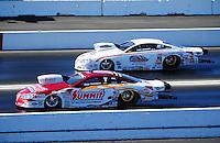 Feb. 27, 2011; Pomona, CA, USA; NHRA pro stock driver Greg Anderson (near) and Kurt Johnson during the Winternationals at Auto Club Raceway at Pomona. Mandatory Credit: Mark J. Rebilas-.