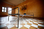 A steel bed frame sits inside a detention cell for high-ranking party cadres at the Tuol Sleng prison in Phnom Penh, Cambodia. As many as 2 million Cambodians -- or one quarter of the population -- died under the Khmer Rouge from 1975 to 1979. An estimated 17,000 of them passed through Tuol Sleng, a former high school converted to a prison by the regime. All but a handful were murdered after an average two months of brutal interrogation. In these cells, prisoners were tortured and sometimes killed while shackled to the bed frames. March 1, 2012.