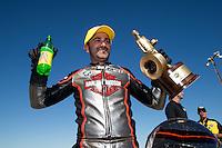 Sept. 22, 2013; Ennis, TX, USA: NHRA pro stock motorcycle rider Eddie Krawiec celebrates after winning the Fall Nationals at the Texas Motorplex. Mandatory Credit: Mark J. Rebilas-