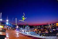 Adam Toth from Hungary performs his trick during the freestyle skiing competition held on the 35 meters high artificial ski jumping ramp on the Monster Energy Fridge Festival in central Budapest, Hungary on November 12, 2011. ATTILA VOLGYI