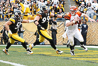 PITTSBURGH, PA - DECEMBER 04:  Andy Dalton #14 of the Cincinnati Bengals is hurried in the endzone by Brett Keisel #99 and James Farrior #51 of the Pittsburgh Steelers during the game on December 4, 2011 at Heinz Field in Pittsburgh, Pennsylvania.  (Photo by Jared Wickerham/Getty Images)