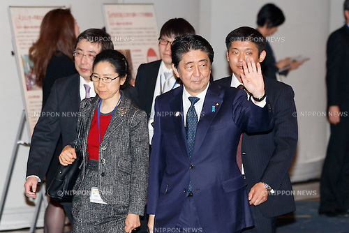 Japanese Prime Minister Shinzo Abe leaves the World Assembly for Women : WAW! 2016 on December 13, 2016, Tokyo, Japan. Female leaders from politics, business, sports and society are attending WAW! 2016 to discuss the roles of women in their countries and affiliations. Japan is trying to increase the participation of women in work and Abe's administration set a goal of increasing the share of women in management roles to 30 percent by 2020. WAW! 2016 is being held from December 13 to 14 at the Grand Prince Hotel New Takanawa in Tokyo. (Photo by Rodrigo Reyes Marin/AFLO)