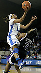 Sophomore guard Bria Goss attacks the basket while High Point senior Erin Reynolds takes a charge at the Women's Basketball game at Memorial Coliseum in Lexington, Ky., on Saturday, November. 17, 2012..
