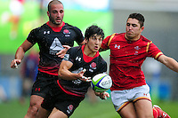Gela Aprasidze of Georgia U20 passes the ball. World Rugby U20 Championship match between Wales U20 and Georgia U20 on June 11, 2016 at the Manchester City Academy Stadium in Manchester, England. Photo by: Patrick Khachfe / Onside Images