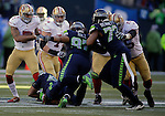 Seattle Seahawks  linebacker K.J. Wright sacks (50) and defensive tackle Jordan Hill (97) sack San Francisco 49ers quarterback Colin Kaepernick (7) at CenturyLink Field in Seattle, Washington on December 14, 2014.  Kapernick was sacked six times in the Seahawks 17-7 win  over the 49ers  © 2014. Jim Bryant Photo. All Rights Reserved.