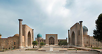 """General view of Registan Square, showing the Sher-Dor, 1619-36, (right), Tillyah-Kori, 1646-60, (centre) and Ulugh Beg, 1417-20, (left) Madrasahs, Samarkand, Uzbekistan, pictured on July 16, 2010, in the morning. The Tillyah-Kori (gilded) Madrasah is part of the Registan Ensemble, surrounding a magnificent square. Commissioned by Yalangtush Bakhadur it is not only a school but also the grand mosque whose lavishly gilded main hall in Kundal style justifies the name. The 75 metre main facade is two-storied with corner turrets.  The dome was only completed during the 20th century Soviet restoration. The Sher-Dor Madrasah, commissioned by Yalangtush Bakhodur as part of the Registan ensemble, and designed by Abdujabor, takes its name, """"Having Tigers"""", from the double mosaic (restored in the 20th century) on the tympans of the portal arch showing suns and tigers attacking deer. The lancet arched portal of this Madradsah, commissioned by the scholarly Ulugh Beg, faces the square and high well-proportioned minarets flank the corners. Geometrically patterned mosaic surroun Samarkand, a city on the Silk Road, founded as Afrosiab in the 7th century BC, is a meeting point for the world's cultures. Its most important development was in the Timurid period, 14th to 15th centuries. Picture by Manuel Cohen."""
