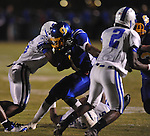 Oxford High's Robert Liggins (1) fumbles vs. Senatobia in high school football in Oxford, Miss. on Friday, September 9, 2011. Oxford won 40-20.