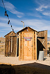 Women and Men and standard wooden outhouses, Nevada