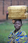 A girl in Riimenze, a village in Southern Sudan's Western Equatoria State, carries a jerry can of water home from a well.