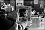 This man checks the haircut in the hand mirror at the end. This mirror is part of Mr. Green's ritual at the end of the job..