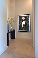 Small hallway is shown with art