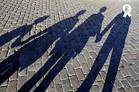 Family of four casting shadows on cobbled stone street, view of shadows Spain, Andalusia, Cordoba (Licence this image exclusively with Getty: http://www.gettyimages.com/detail/sb10068805b-001 )